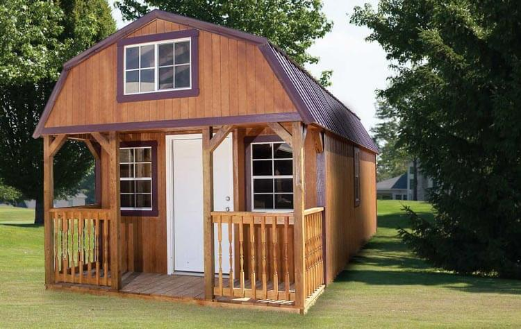 Stained Lofted Cabin with a metal roof