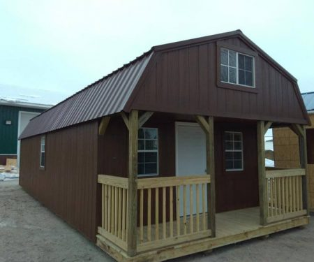 Painted Lofted Cabin with a metal roof