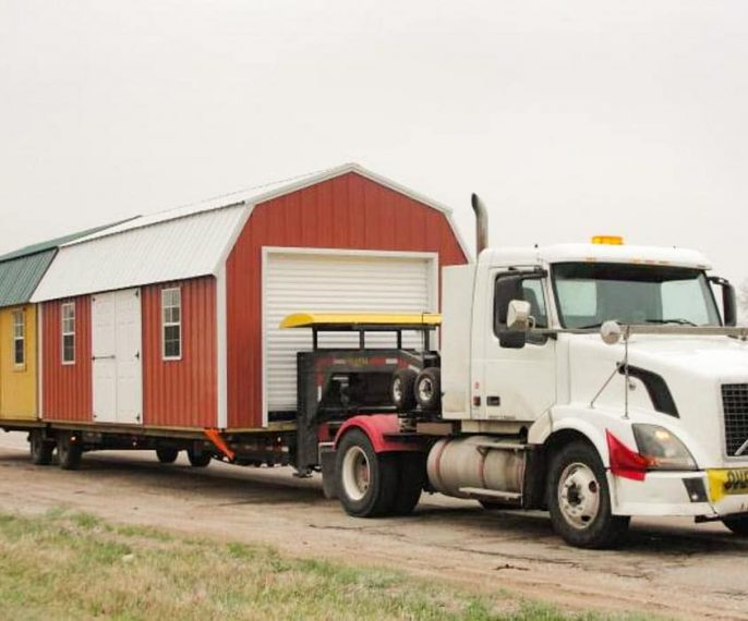 Mid-America Structure delivery truck with two sheds on the trailer